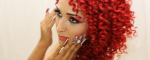 red haired model with jeweled nails