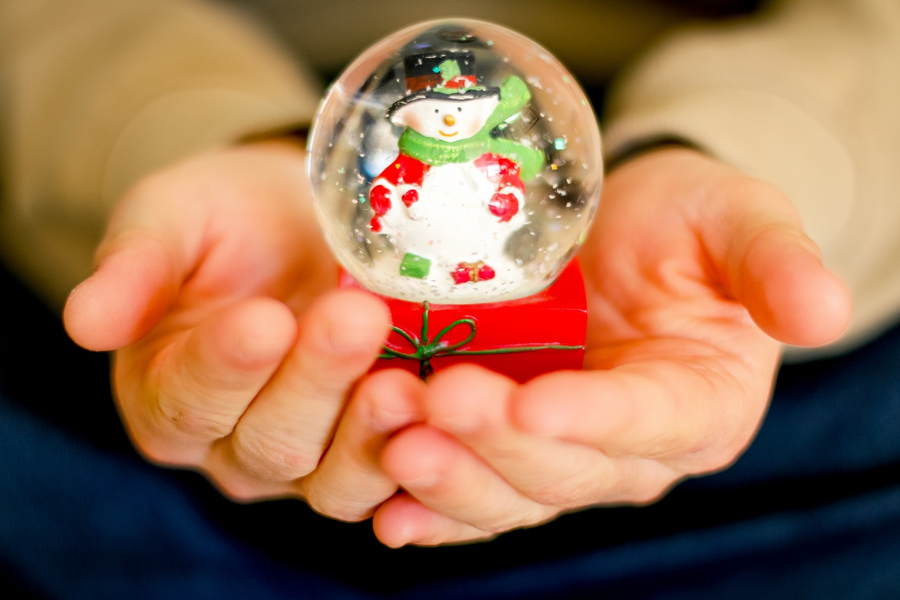giving a snowglobe